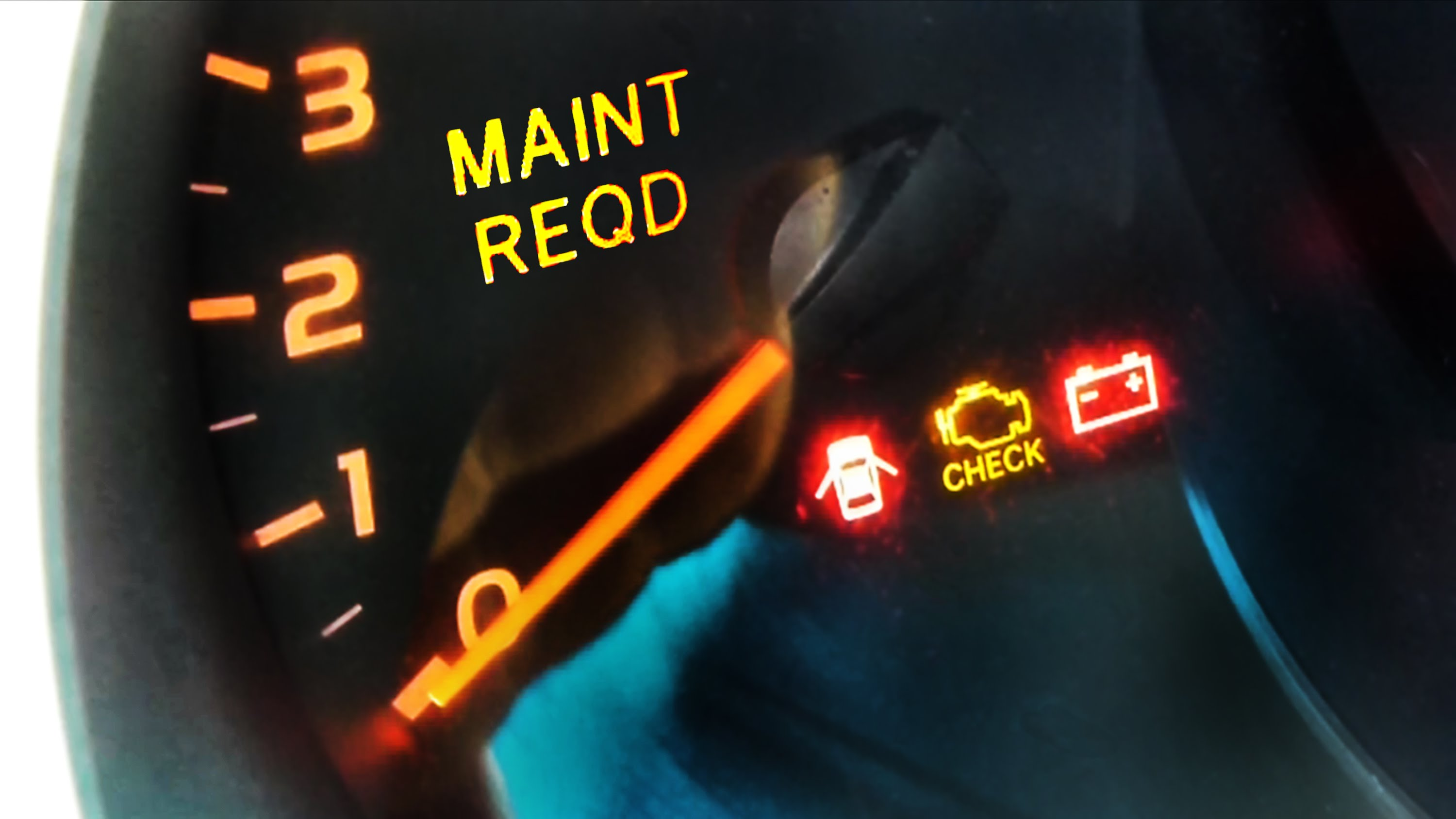 Image of Lexus dashboard showing Maintenance required light.